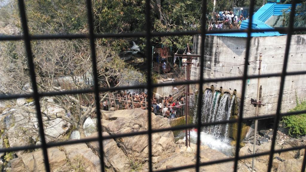 people bathing at hogenakkal